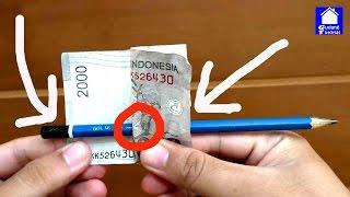 Rahasia Sulap Melubangi Uang Kertas dengan Pensil