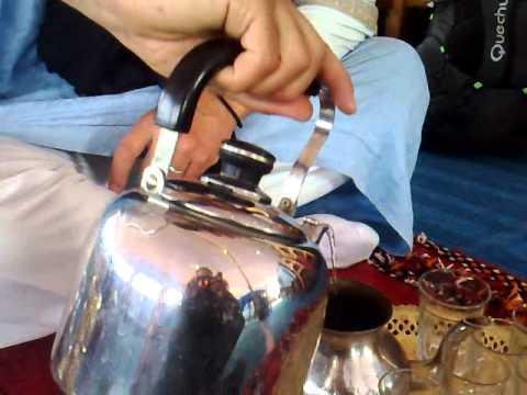 Cleaning green tea to prepare Moroccan tea in Berber village of Nkob Morocco