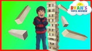 getlinkyoutube.com-GIANT JENGA like Wooden Tumbling Tower Family fun game for kids Kinder Egg Surprise Toys