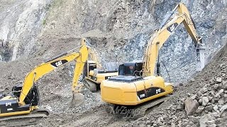 getlinkyoutube.com-CAT 320D2 320D Excavator Working On Rocks Quarry