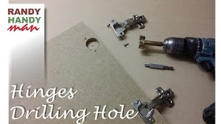 Drilling holes for concealed door hinges. Making holes for cupboard hinges.