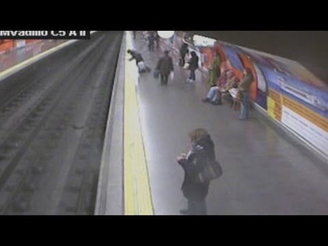 Dramatic footage: Woman faints and falls on Madrid's Metro rail track