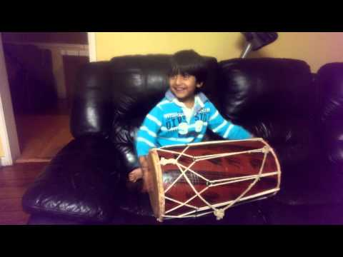 Rudra playing dholki