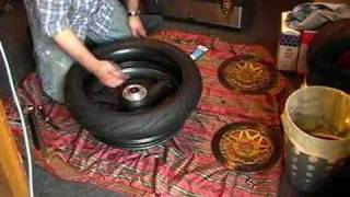 getlinkyoutube.com-Change a motorcycle tyre by hand.