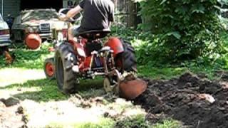 getlinkyoutube.com-garden tractor plowing with chicken oppertunists