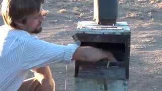 getlinkyoutube.com-wood stove runs a generator, produces gasoline, runs a fridge and heats hot water at the same time