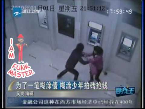 Woman robbed at ATM
