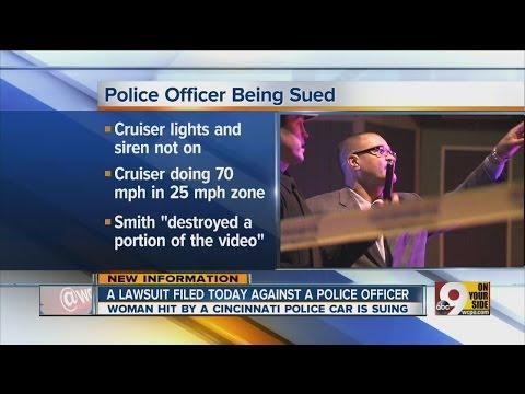 Police cruiser hit woman