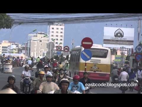 road traffic with cars and  much more motorbikes  at Cầu Xóm Bóng Bridge  around Thap Ba  Nha T