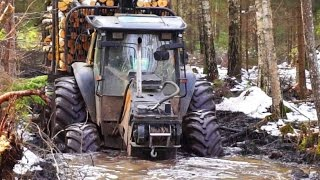 getlinkyoutube.com-Valtra forestry tractor with big fully loaded trailer in wet snowy forest