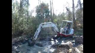 getlinkyoutube.com-Mud bogging with the mini Excavator