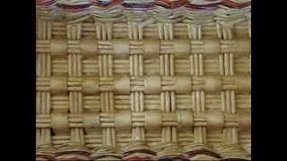 Weaving a rectangular bottom of a basket from newspapers