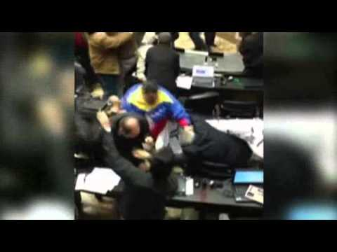 Bloody brawl between lawmakers breaks out in Venezuela's parliament amid election conflict, 22 injured
