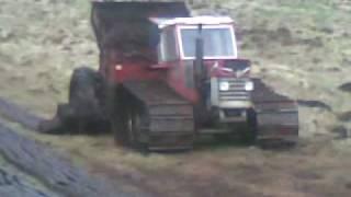 getlinkyoutube.com-Massey Ferguson 168 on tracks