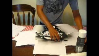 getlinkyoutube.com-Juvenal Hernandez, Expert Village - How to spray paint a stencil onto a shirt.