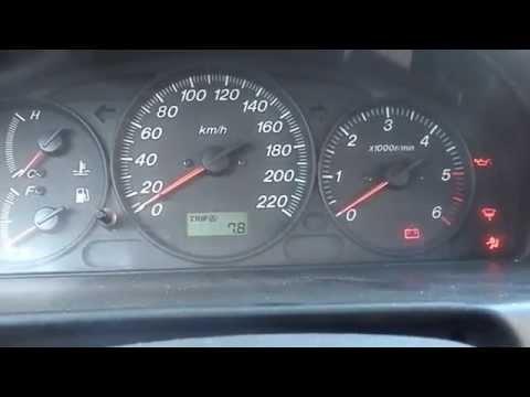 Расположение аккумулятора в Mazda Фамилия