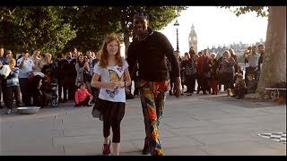 getlinkyoutube.com-Tourist girl is challenged by street performers in central London