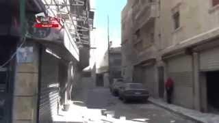 هام : لحظة سقوط برميل متفجر على حي الكلاسة وحالة هلع بين المدنيين وانتشال الجثث 18 4 2014