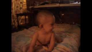 Funny baby falls off bed