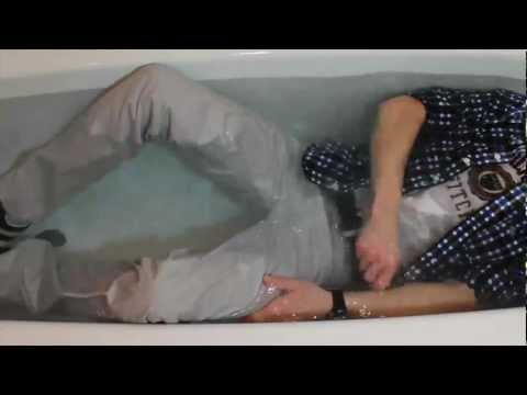 in the bathtub wearing A&F clothes, levis 551 jeans, puma suede sneaks....