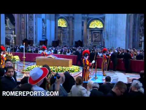 Thousands pray before the casket of John Paul II