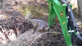 getlinkyoutube.com-John Deere 1025r digging out a beaver dam