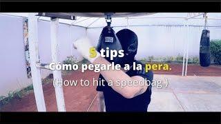 ¿Cómo pegarle a la pera o speedbag?