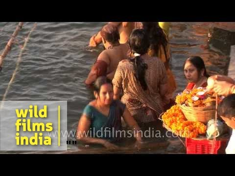 Women bathing in Ganges river during Shivratri, Varanasi