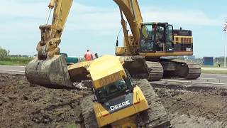 "getlinkyoutube.com-345CL Excavator Pulls Out 2 Deere Dozers From a Canal ""Stuck?"""
