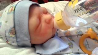 getlinkyoutube.com-Silicone Baby Dakota Drinks all of his Bottle!