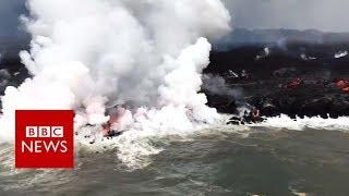 Molten lava meets the sea - BBC News