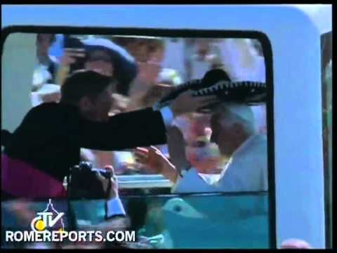 Pope wears Mexican 'sombrero' as he greets the crowd in Popemobile