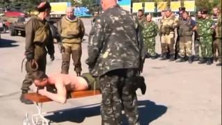 Russian Cossack Insurgents Whip Troops: Corporal punishment staged to deter drunken lawlessness