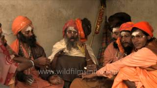 getlinkyoutube.com-Sadhus smoke marijuana in a chillum