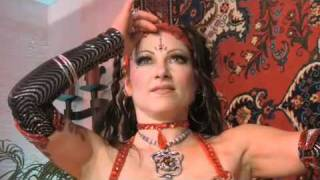 Serpentine Sorceress Jenevieve dances with snake