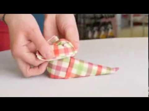 pliage de serviette en botte de noël