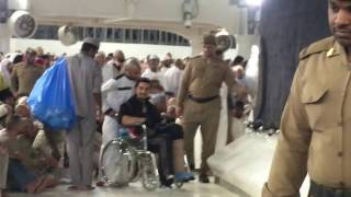 getlinkyoutube.com-Touching the black stone by the Kaaba in wheelchair