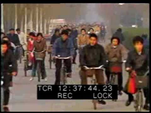 Beijing - China - Man Doing Tai Chi - Riding Bicycles in China - Best Shot Footage - Stock Footage