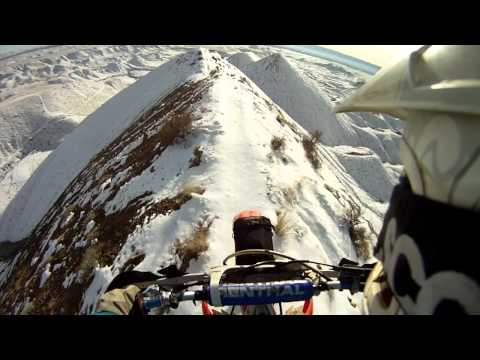Crazy Motorcyclist Riding on Mountain Top