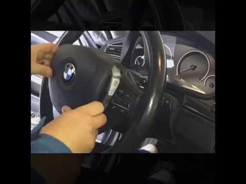 Где находится у BMW 7 блок управления подушками безопасности