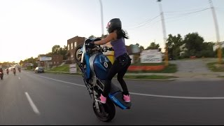 getlinkyoutube.com-Crazy girl does motorcycle stunts on St. Louis streets 2015