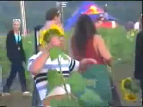 Man has trouble dancing with his sunflower