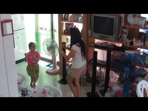 Beautiful little Thai girl learning to dance with her pretty Thai dance teacher , Rangsit , Bangkok