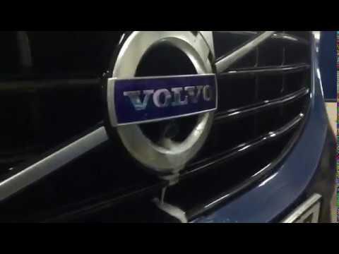 Где находится в Вольво XC40 моторчик омывателя заднего стекла