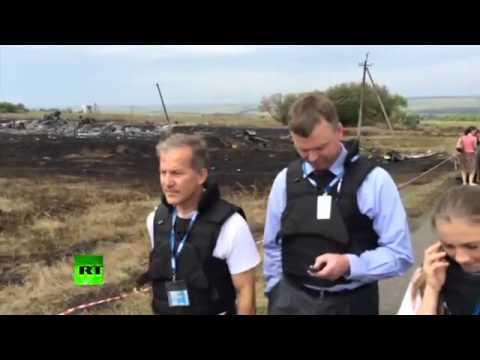 С места крушения Боинга 777 начали воровать трупы людей