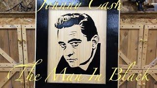 Cutting a Johnny Cash portrait on a scroll saw