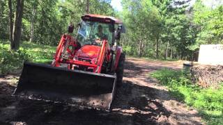 getlinkyoutube.com-Kioti Tractor Loading a Dump Trailer