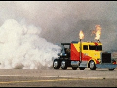 Shockwave jet truck drag races airplane