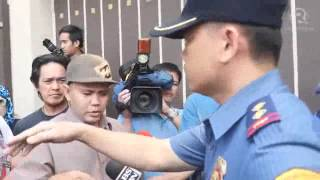 Police dismissing Iglesia supporters from Manalo compound