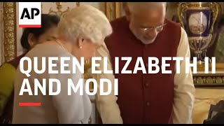 Queen and Modi look at palace artefacts